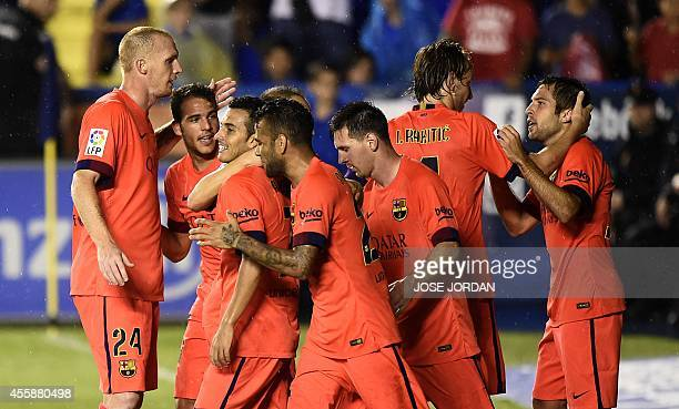 Barcelona's forward Pedro Rodriguez celebrates his goal with teammates during the Spanish league football match Levante UD vs FC Barcelona at the...