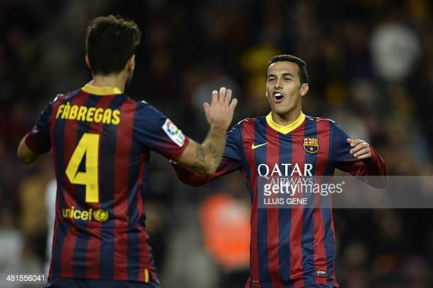 Barcelona's forward Pedro Rodriguez celebrates with Barcelona's midfielder Cesc Fabregas after scoring during the Spanish league football match FC...