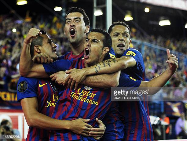 Barcelona's forward Pedro Rodriguez celebrates with his teammates after scoring his team's first goal during the Spanish King's Cup final football...