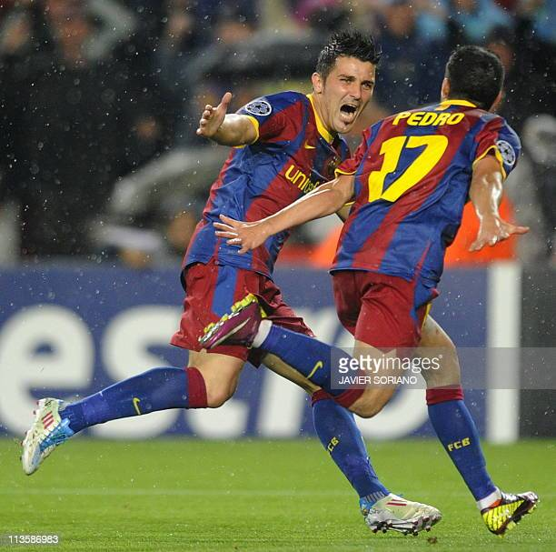 Barcelona's forward Pedro Rodriguez celebrates with teammate forward David Villa after scoring during the Champions League semifinal second leg...