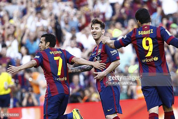 Barcelona's forward Pedro Rodriguez celebrates with teammate Barcelona's Argentinian forward Lionel Messi after scoring during the Spanish league...