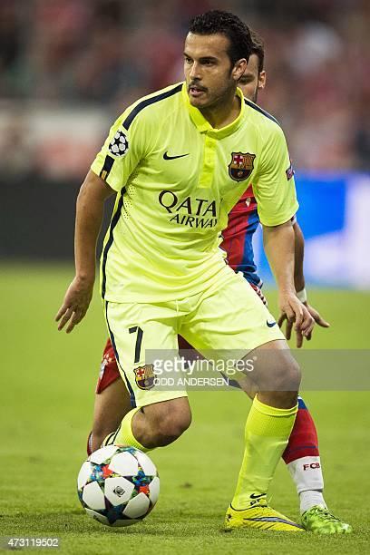 Barcelona's forward Pedro Rodriguez controls the ball during the UEFA Champions League semifinal second leg football match FC Bayern Munich vs FC...
