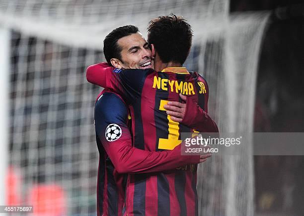 Barcelona's forward Pedro Rodriguez is congratulated by teammate Barcelona's Brazilian forward Neymar da Silva Santos Junior after scoring during the...