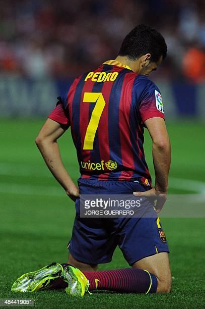 Barcelona's forward Pedro Rodriguez reacts during the Spanish league football match Granada CF vs FC Barcelona at the Nuevo Los Carmenes stadium in...