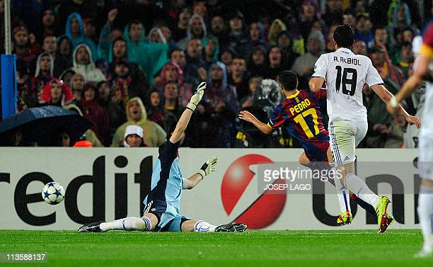 Barcelona's forward Pedro Rodriguez scores against Real Madrid's goalkeeper Iker Casillas during the Champions League semifinal second leg football...