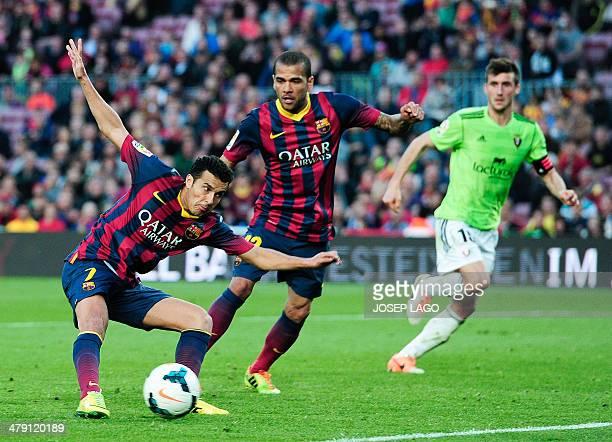 Barcelona's forward Pedro Rodriguez scores during the Spanish league football match FC Barcelona vs Osasuna at the Camp Nou stadium in Barcelona on...