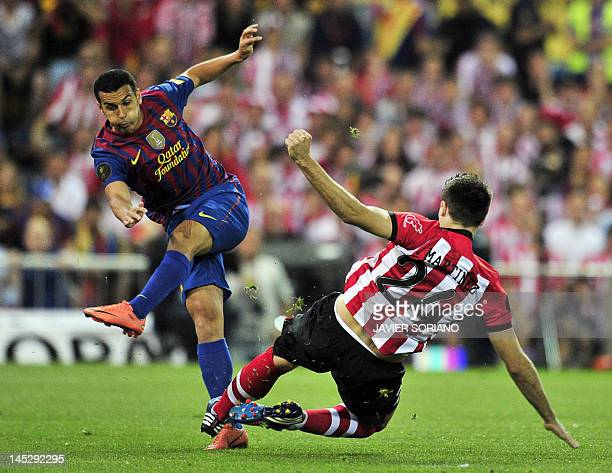 Barcelona's forward Pedro Rodriguez scores past Athletic Bilbao's midfielder Javi Martinez during the Spanish King's Cup final football match between...
