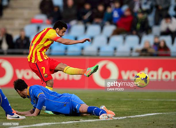 Barcelona's forward Pedro Rodriguez shoots to score his third goal goal during the Spanish league football match Getafe CF vs FC Barcelona at the...