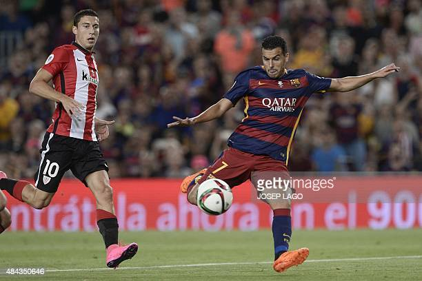 Barcelona's forward Pedro Rodriguez vies with Athletic Bilbao's midfielder Oscar de Marcos during the Spanish Supercup secondleg football match FC...