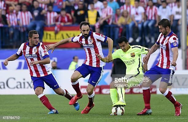 Barcelona's forward Pedro Rodriguez vies with Atletico Madrid's midfielder Koke Atletico Madrid's defender Juanfran and Atletico Madrid's midfielder...