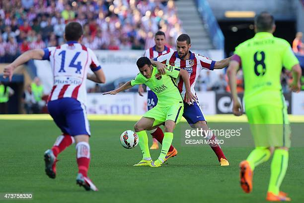 Barcelona's forward Pedro Rodriguez vies with Atletico Madrid's midfielder Mario Suarez during the Spanish league football match Club Atletico de...
