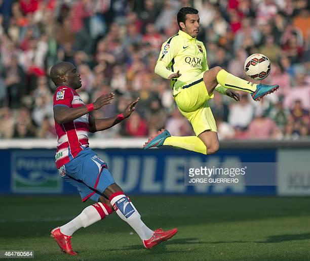Barcelona's forward Pedro Rodriguez vies with Granada's French defender Jean Sylvain Babin during the Spanish league football match Granada CF vs FC...