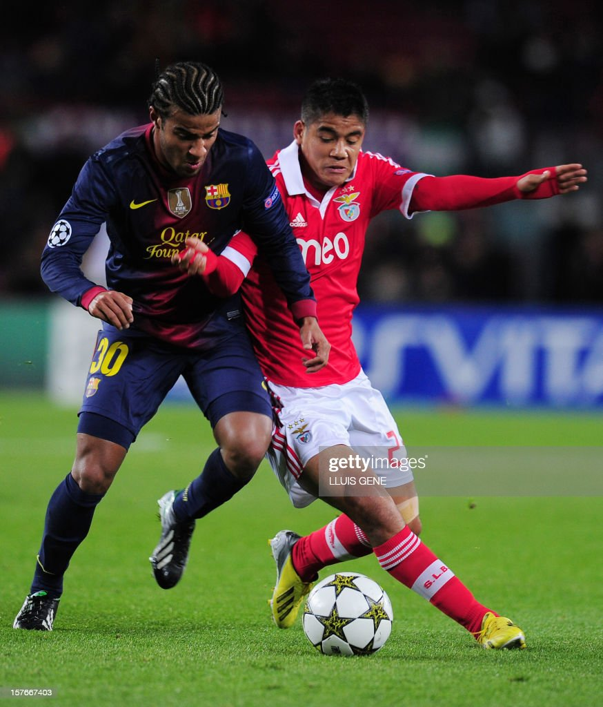 Barcelona's forward Rafinha (L) vies with Benfica's Paraguayan forward Lorenzo Melgarejo during the UEFA Champions League football match FC Barcelona vs SL Benfica at the Camp Nou stadium in Barcelona on December 5, 2012.
