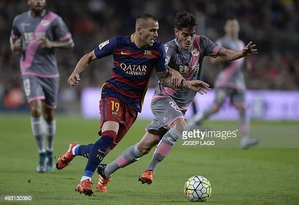 Barcelona's forward Sandro vies with Rayo Vallecano's midfielder Jozabed during the Spanish league football match FC Barcelona vs Rayo Vallecano de...