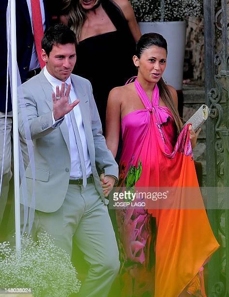 Barcelona's foward Lionel Messi and his girlfriend Antonella Roccuzzo arrive for the wedding ceremony of Spain's midfielder Andres Iniesta in...