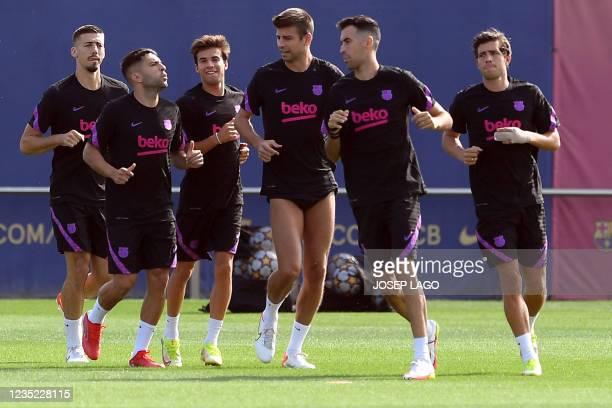 Barcelona's French defender Clement Lenglet, Barcelona's Spanish defender Jordi Alba, Barcelona's Spanish midfielder Riqui Puig, Barcelona's Spanish...