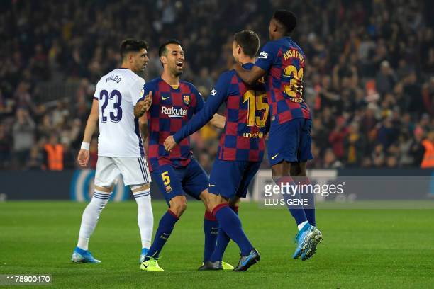 Barcelona's French defender Clement Lenglet celebrates scoring the opening goal during the Spanish league football match between FC Barcelona and...