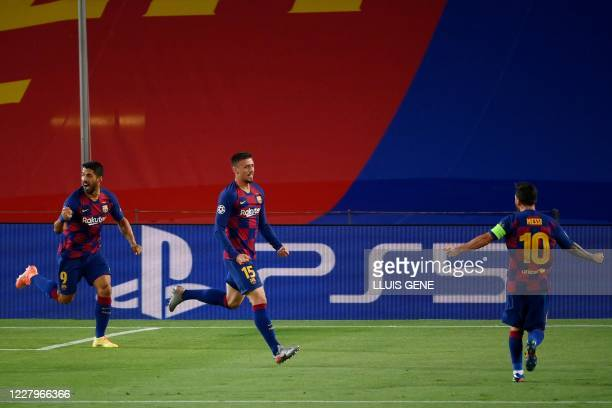 Barcelona's French defender Clement Lenglet celebrates with Barcelona's Argentine forward Lionel Messi and Barcelona's Uruguayan forward Luis Suarez...