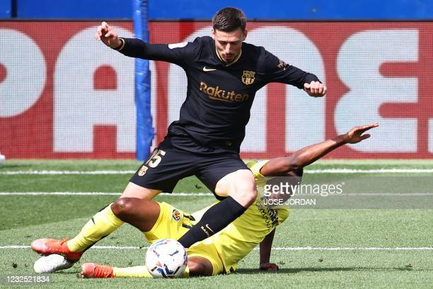 Barcelona's French defender Clement Lenglet challenges Villarreal's Nigerian midfielder Samuel Chukwueze during the Spanish League football match...
