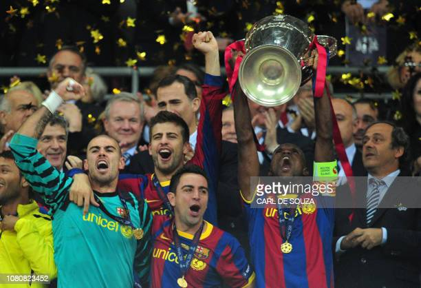 Barcelona's French defender Eric Abidal celebrates with the trophy at the end of the UEFA Champions League final football match FC Barcelona vs...