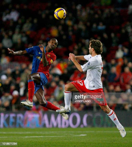 Barcelona's French defender Eric Abidal fights for the ball with Numancia«s Barkero during the Liga football match Barcelona vs Numancia at the New...