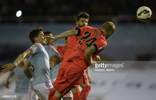 Barcelona's French defender Jeremy Mathieu heads the ball to score a goal during the Spanish league football match RC Celta de Vigo vs FC Barcelona...