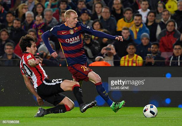 Barcelona's French defender Jeremy Mathieu vies with Athletic Bilbao's defender Inigo Lekue during the Spanish Copa del Rey quarterfinals second leg...