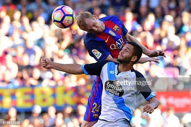 Barcelona's French defender Jeremy Mathieu vies with Deportivo's Romanian forward Florin Andone during the Spanish league football match FC Barcelona...