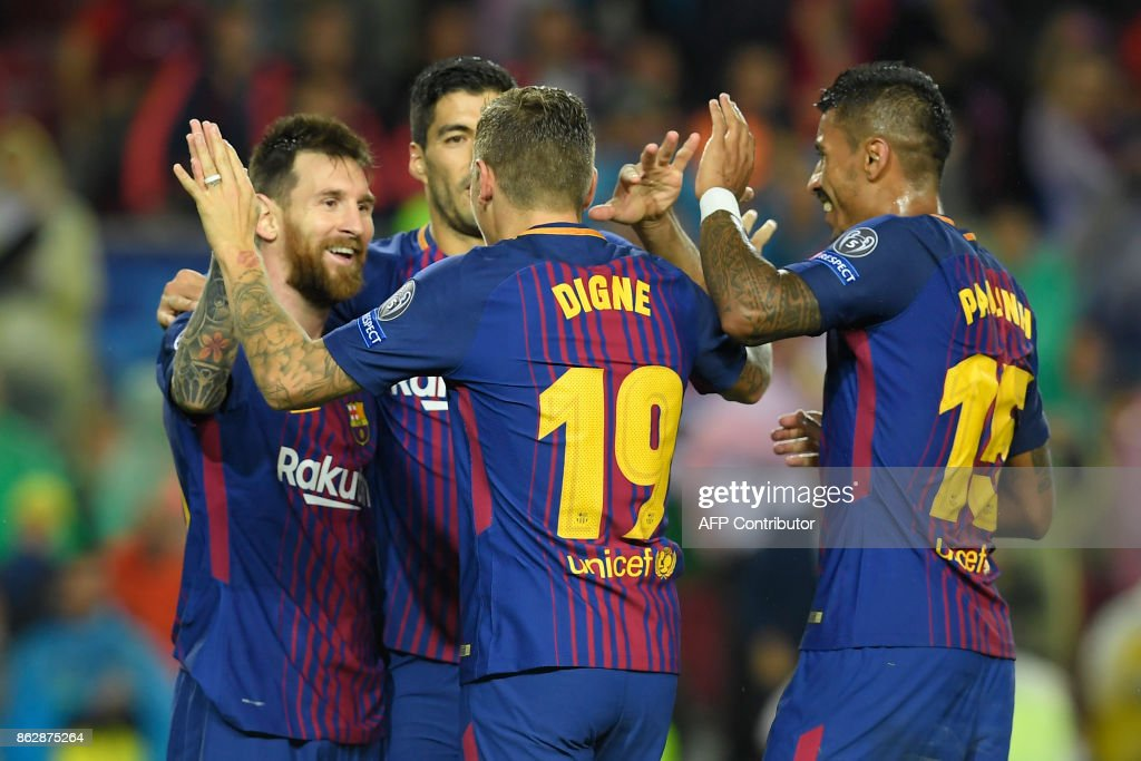 Barcelona's French defender Lucas Digne (2R) celebrates a goal with Barcelona's Argentinian forward Lionel Messi (L), Barcelona's Uruguayan forward Luis Suarez (2L) and Barcelona's Brazilian midfielder Paulinho during the UEFA Champions League group D football match FC Barcelona vs Olympiacos FC at the Camp Nou stadium in Barcelona on Ocotber 18, 2017. /