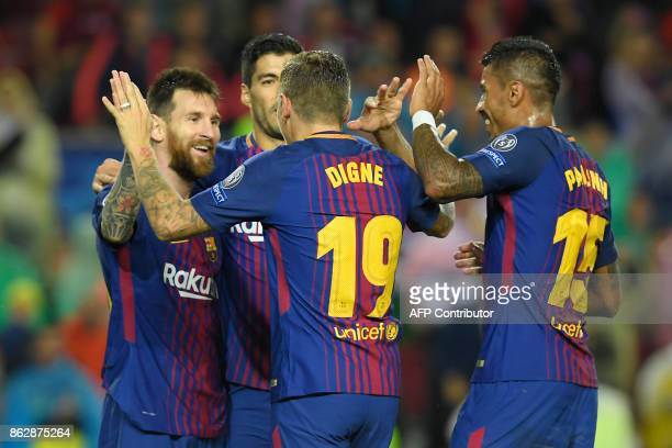 Barcelona's French defender Lucas Digne celebrates a goal with Barcelona's Argentinian forward Lionel Messi Barcelona's Uruguayan forward Luis Suarez...