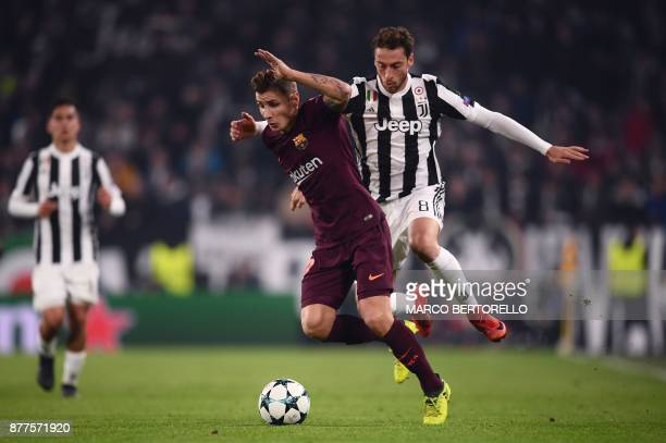 Barcelona's French defender Lucas Digne fights for the ball with Juventus' midfielder from Italy Claudio Marchisio during the UEFA Champions League...