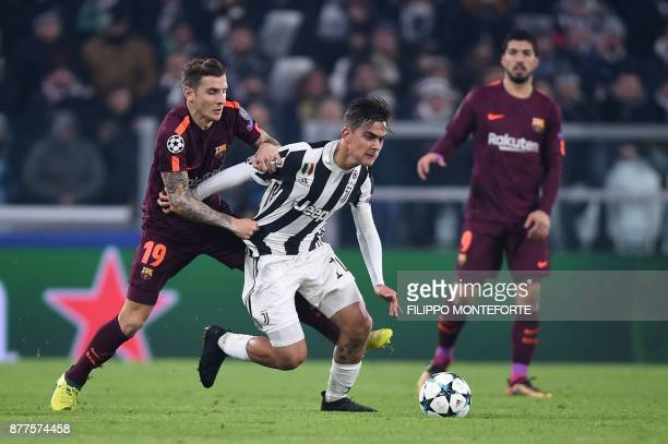Barcelona's French defender Lucas Digne fights for the ball with Juventus' forward from Argentina Paulo Dybala during the UEFA Champions League Group...