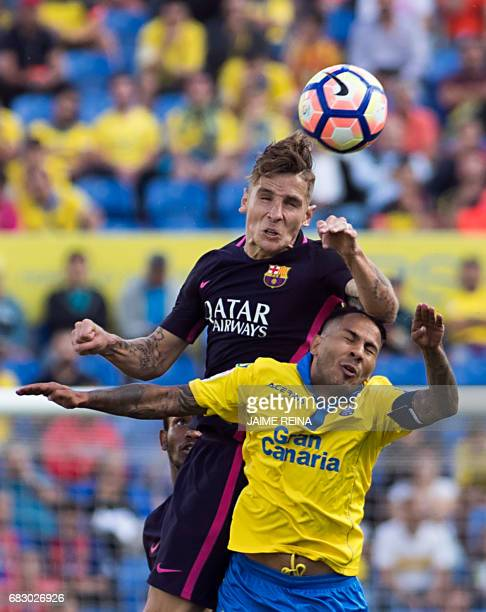 Barcelona's French defender Lucas Digne vies with Las Palmas' forward Jonathan Viera during the Spanish league football match UD Las Palmas vs FC...