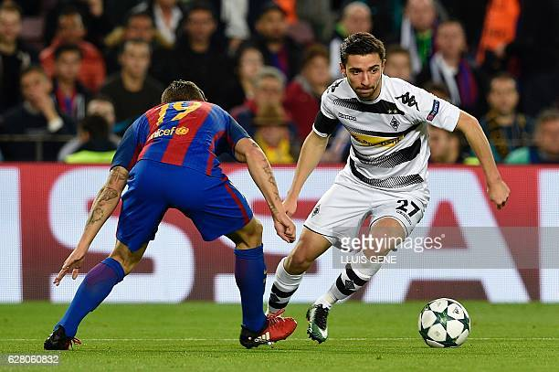 Barcelona's French defender Lucas Digne vies with Moenchengladbach's defender Julian Korb during the UEFA Champions League Group C football match FC...