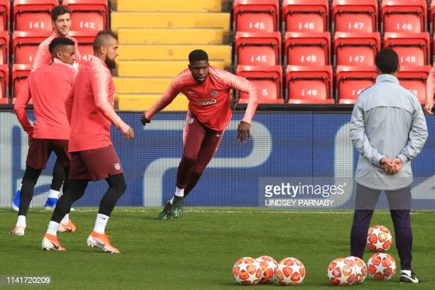 Barcelona's French defender Samuel Umtiti attends a training session at Anfield stadium in Liverpool, north west England on on May 6 on the eve of...
