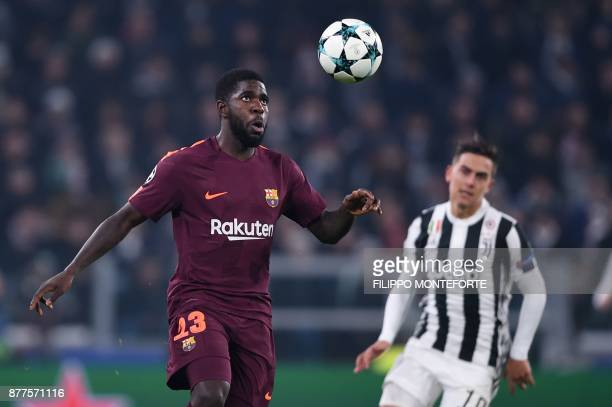 Barcelona's French defender Samuel Umtiti eyes the ball during the UEFA Champions League Group D football match Juventus Barcelona on November 22...
