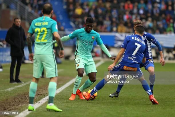 Barcelona's French defender Samuel Umtiti vies with Deportivo AlavesÕ forward Ruben Sobrino during the Spanish league football match Deportivo Alaves...