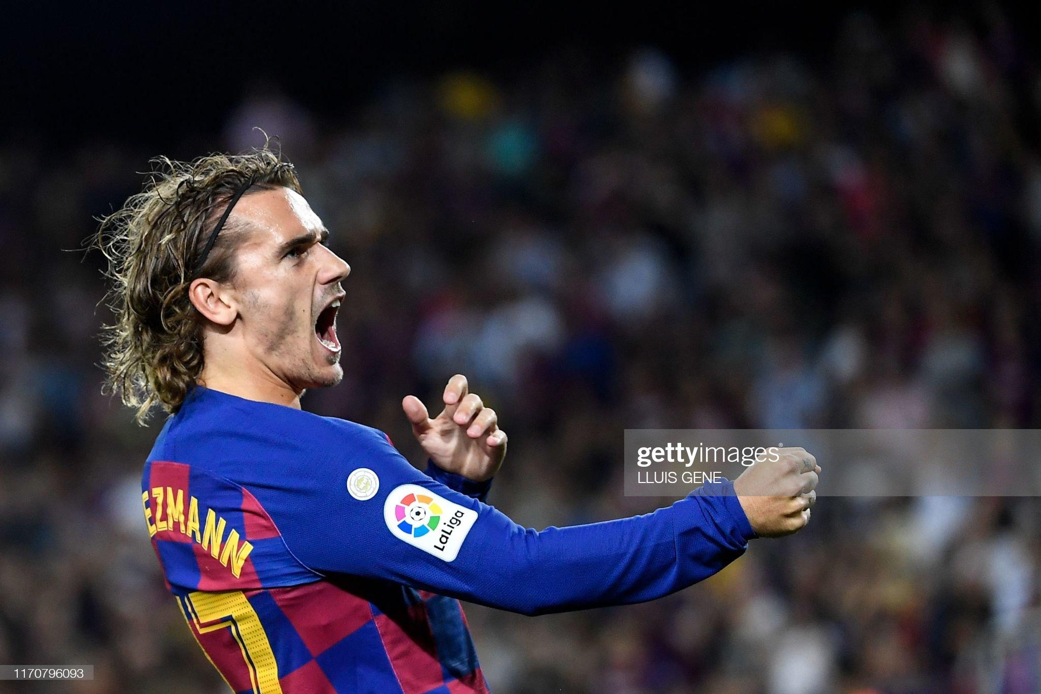 صور مباراة : برشلونة - فياريال 2-1 ( 24-09-2019 )  Barcelonas-french-forward-antoine-griezmann-celebrates-after-scoring-picture-id1170796093?s=2048x2048