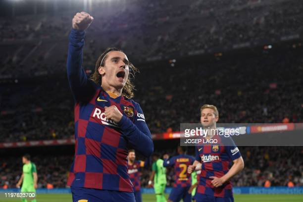 Barcelona's French forward Antoine Griezmann celebrates after scoring the opening goal during the Copa del Rey football match between FC Barcelona...