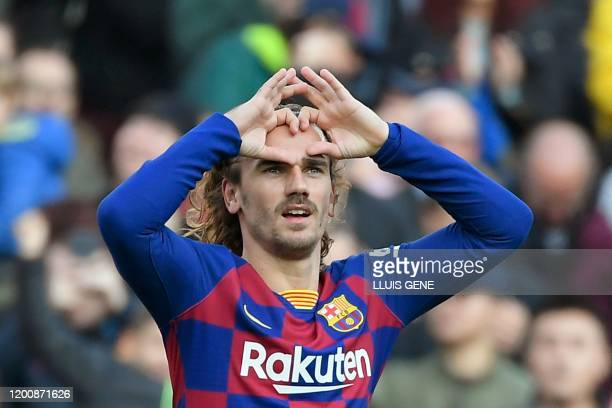Barcelona's French forward Antoine Griezmann celebrates after scoring during the Spanish league football match between FC Barcelona and Getafe CF at...