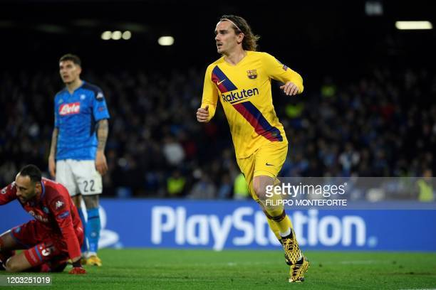 Barcelona's French forward Antoine Griezmann celebrates after scoring a goal during the UEFA Champions League round of 16 firstleg football match...