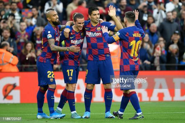 Barcelona's French forward Antoine Griezmann celebrates with Barcelona's Chilean midfielder Arturo Vidal Barcelona's Uruguayan forward Luis Suarez...