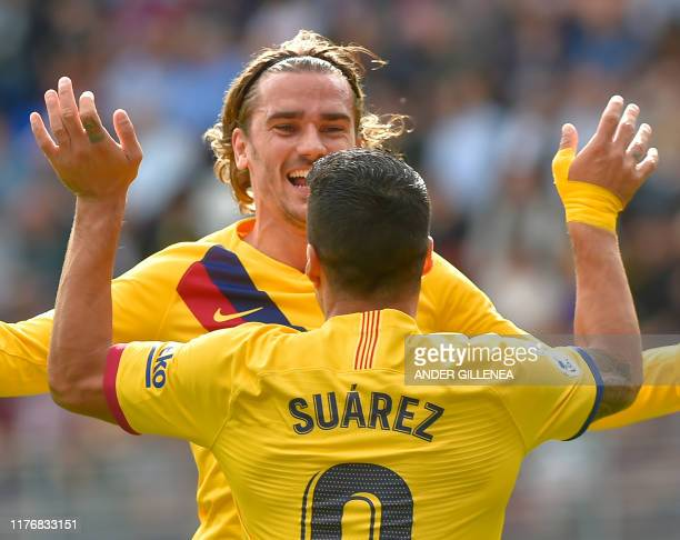 Barcelona's French forward Antoine Griezmann celebrates with Barcelona's Uruguayan forward Luis Suarez after scoring during the Spanish league...