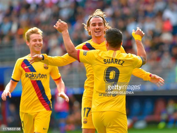 Barcelona's French forward Antoine Griezmann celebrates with Barcelona's Uruguayan forward Luis Suarez and Barcelona's Dutch midfielder Frenkie De...