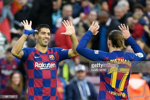 TOPSHOT Barcelona's French forward Antoine Griezmann celebrates with Barcelona's Uruguayan forward Luis Suarez after scoring a goal during the...