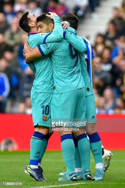 Barcelona's French forward Antoine Griezmann celebrates with teammates Barcelona's Uruguayan forward Luis Suarez and Barcelona's Argentine forward...