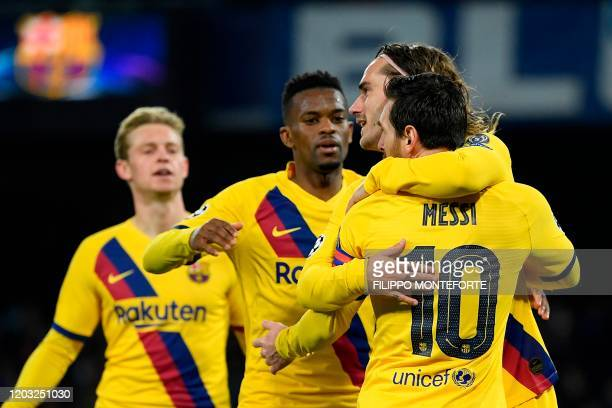 Barcelona's French forward Antoine Griezmann celebrates with teammates after scoring a goal during the UEFA Champions League round of 16 firstleg...