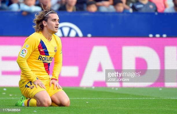 Barcelona's French forward Antoine Griezmann kneels on the field after missing a goal opportunity during the Spanish League football match between...