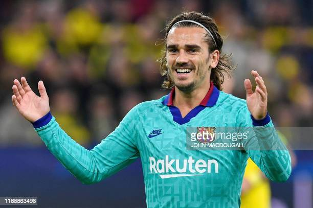 Barcelona's French forward Antoine Griezmann reacts to a missed chance during the UEFA Champions League Group F football match Borussia Dortmund v FC...