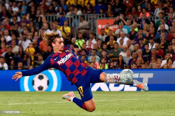 Barcelona's French forward Antoine Griezmann scores a goal during the Spanish League football match between Barcelona and Real Betis at the Camp Nou...